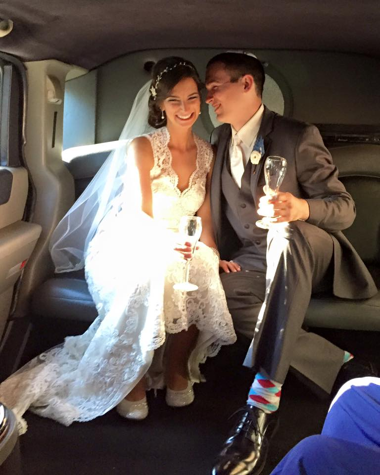 Wedding Couple in a Motortoys Limousine H2 Hummer Limo